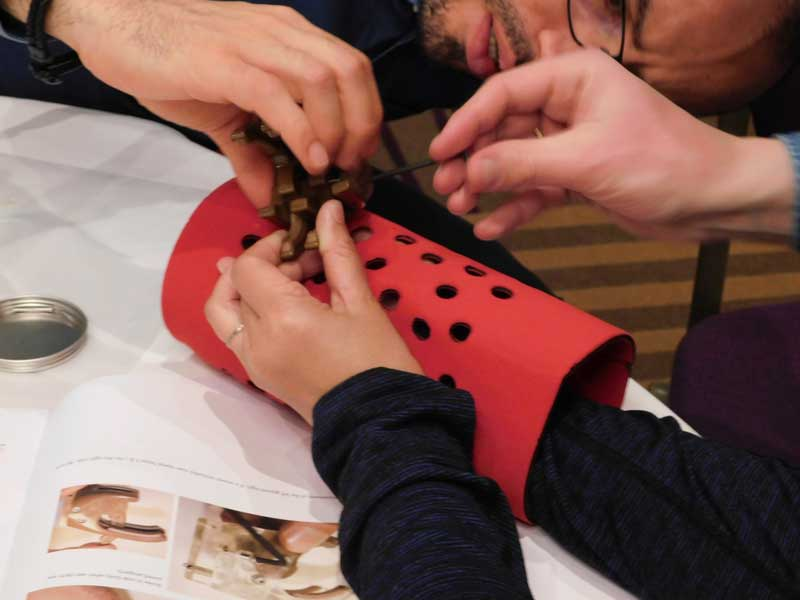 teambuilding-team-building-working-together-to-assemble-prosthetic-hand